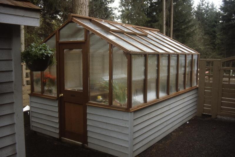 Traditional greenhouse on white base
