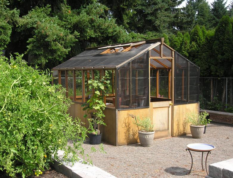 Freestanding greenhouse with shade cloth panels