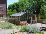 Painted redwood greenhouse on brick base
