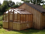Redwood greenhouse attached to a shed