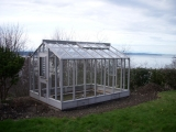 Glass-to-ground greenhouse in Seattle, WA