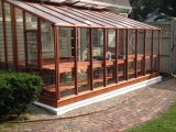 Glass to ground lean-to greenhouse