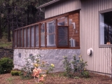 Lean-to greenhouse on cement blocks