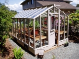 Glass to ground redwood greenhouse stained gray
