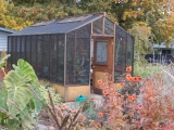 tall greenhouse with shade cloth