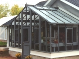 Large greenhouse attached at gable end