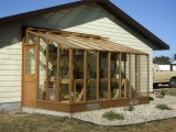 Lean-to greenhouse attached to house