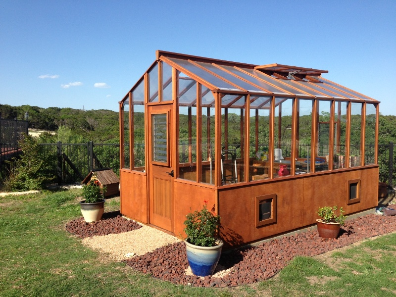Redwood greenhouse Texas with twin wall roof