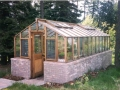 Greenhouse on brick base with Jalousie windows
