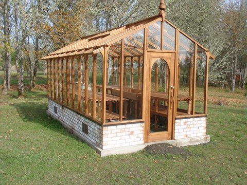 Redwood and glass greenhouse