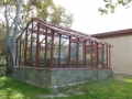 Redwood & glass greenhouse in Salinas CA from the back