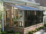 Garden sun room greenhouse with shade cloth