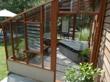 Interior of Garden Sun room with triangular hot tub