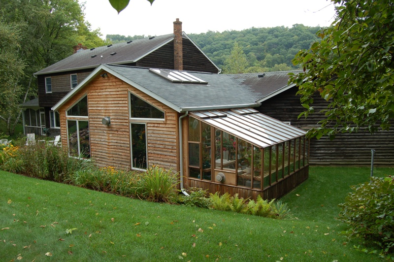 Wooden garden sun room greenhouse that fits with house