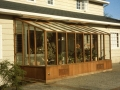 Garden sun room greenhouse built under the eave