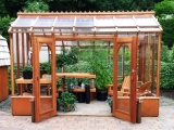 Redwood greenhouse with sitting area