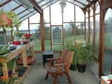 Greenhouse interior showing roof beams and twin wall roof