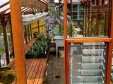 Glass greenhouse with Jalousie window