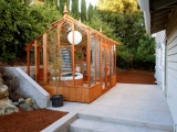 Tall glass greenhouse with Spa inside