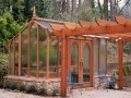 Greenhouse with arbor in front