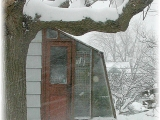 Redwood greenhouse in snow