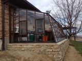 Redwood greenhouse in Indiana with Jalousie windows