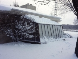 Lean-to greenhouse in snow