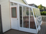 Redwood lean-to greenhouse painted white