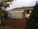 lean-to-greenhouse under roof eave
