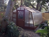 Redwood greenhouse with all polycarbonate glazing