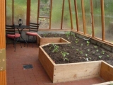 Greenhouse interior with raised beds