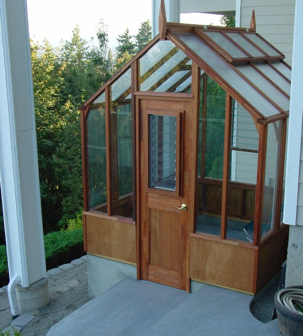 Under deck small wood greenhouse