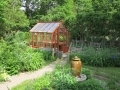 Small home greenhouse in a garden