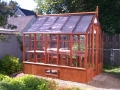 Trillium home greenhouse with shade cloth