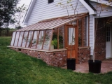 Redwood greenhouse built into ground