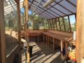Interior of large home redwood greenhouse
