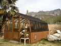 Redwood greenhouse with shade cloth