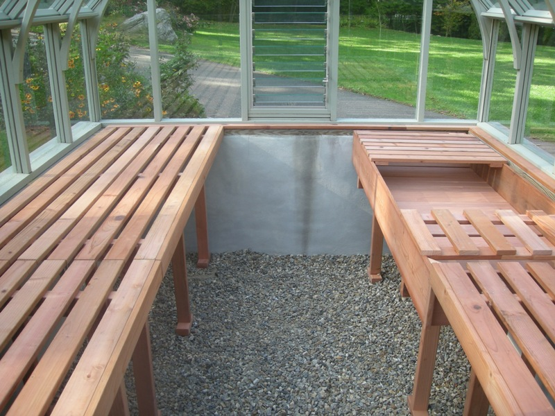 Redwood greenhouse interior with garden bench