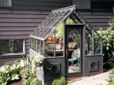 Compact Home greenhouse with steep roof