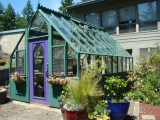 Brightly painted wood greenhouse