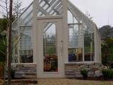 Custom Tudor Glass Greenhouse on shorter base wall