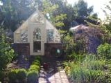 Tudor style garden greenhouse with brick base wall