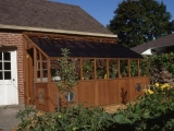 Lean-to greenhouse attached to a garage