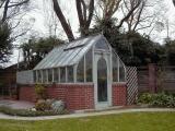 Home redwood greenhouse on brick base