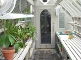 Interior of redwood greenhouse stained gray