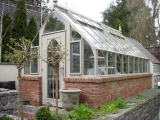 Home greenhouse on brick base in SF bay area