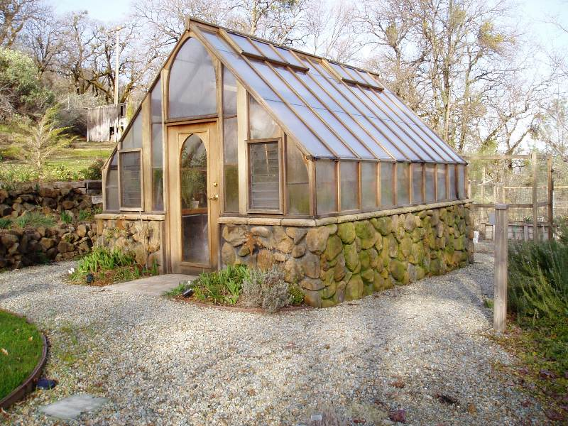 Redwood and Glass greenhouse on stone base
