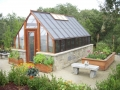 Tudor style home greenhouse with masonry base