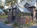 Tudor redwood greenhouse, attached at gable end and stained brown