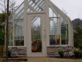 Custom Tudor Glass Greenhouse on shorter base wall